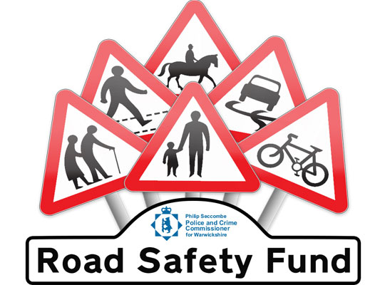 a bunch of road safety signs with a sign below saying 'Road Safety Fund'