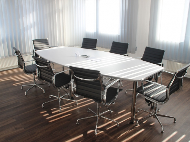 Empty chairs around meeting table