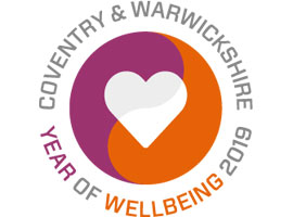 Logo white heart in red and puple circle with the text, Coventry & Warwickshrie Year of Wellbeing 2019